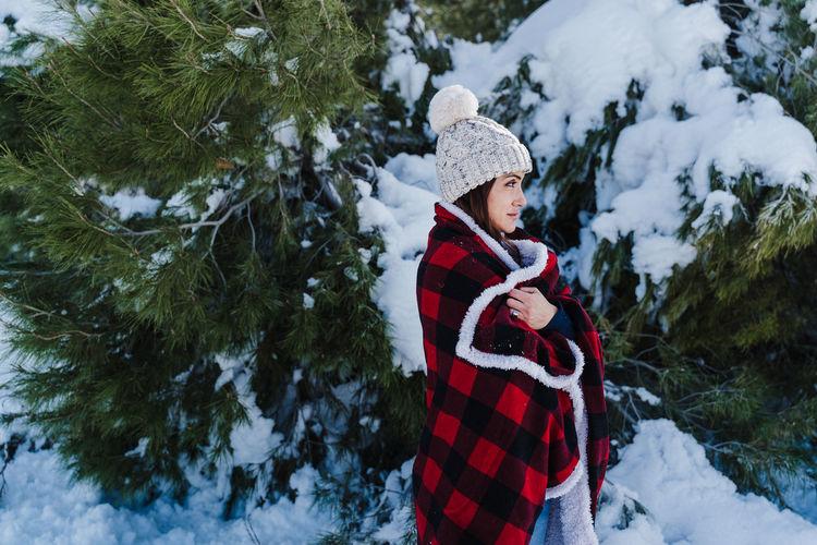 Man wearing hat on tree during winter