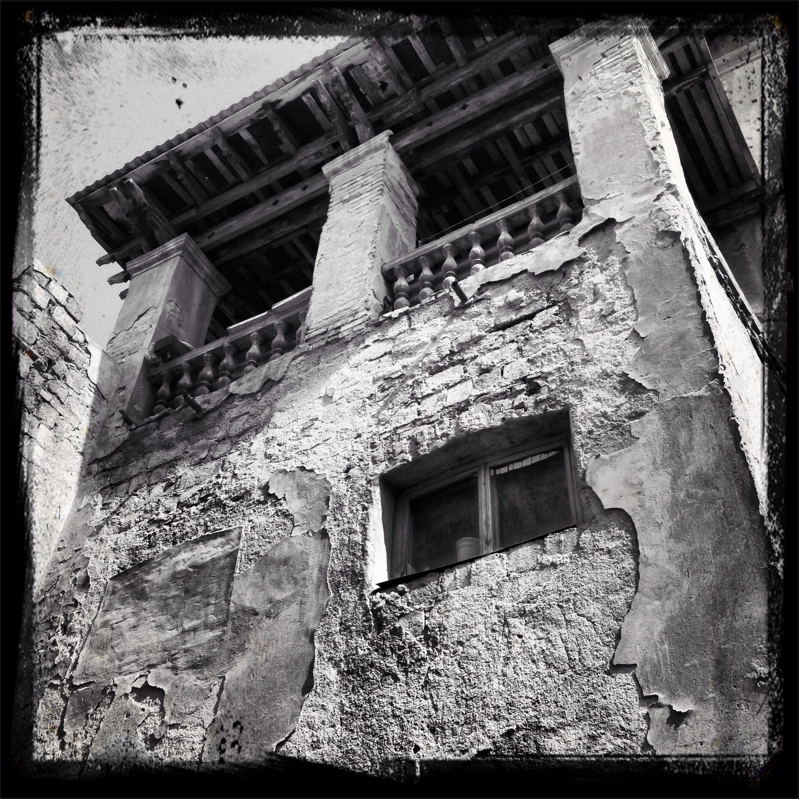architecture, built structure, building exterior, low angle view, old, window, transfer print, abandoned, auto post production filter, house, history, damaged, weathered, building, old ruin, run-down, exterior, residential structure, obsolete, the past