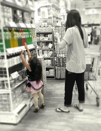 Reaching. IPhoneography Iphonephotography IP6s Mother Mother And Daughter Mother And Little Girl Shopping Food Store Asian Store Food Market Pink Color The Photojournalist - 2016 EyeEm Awards
