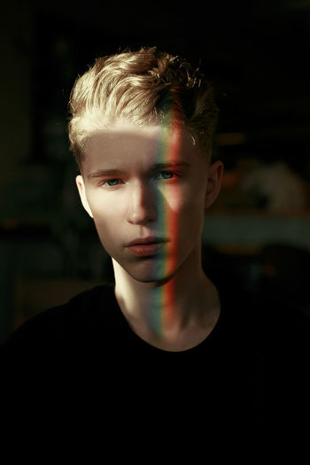 Portrait of man with spectrum on face