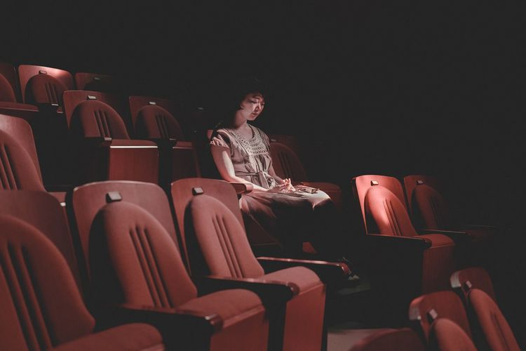 Art Is Everywhere Seat Movie Theater Chair Sitting Arts Culture And Entertainment Film Industry Theater Real People One Person Indoors  Relaxing EyeEm Best Shots TCPM EyeEmNewHere Lifestyles Women