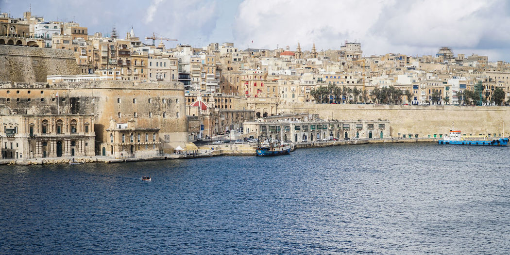 Panorama of Mediterranean, Middle East type architecture city next to the sea / river - Valletta / Malta Ancient Architecture Architecture Building Building Exterior Built Structure City City Cityscape Grand Harbour Harbor Houses Italy Malta Medieval Mediterranean  Mediterranean Sea Middle East Panorama Port River Travel Destinations Valletta Water Waterfront