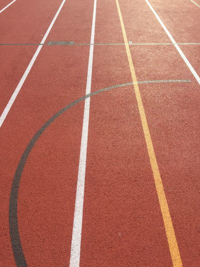 Running Track Track And Field Sport Sports Track Full Frame Day Outdoors Starting Line Competition No People Backgrounds Red Track And Field Stadium Sports Race Competitive Sport Close-up Track And Field Event
