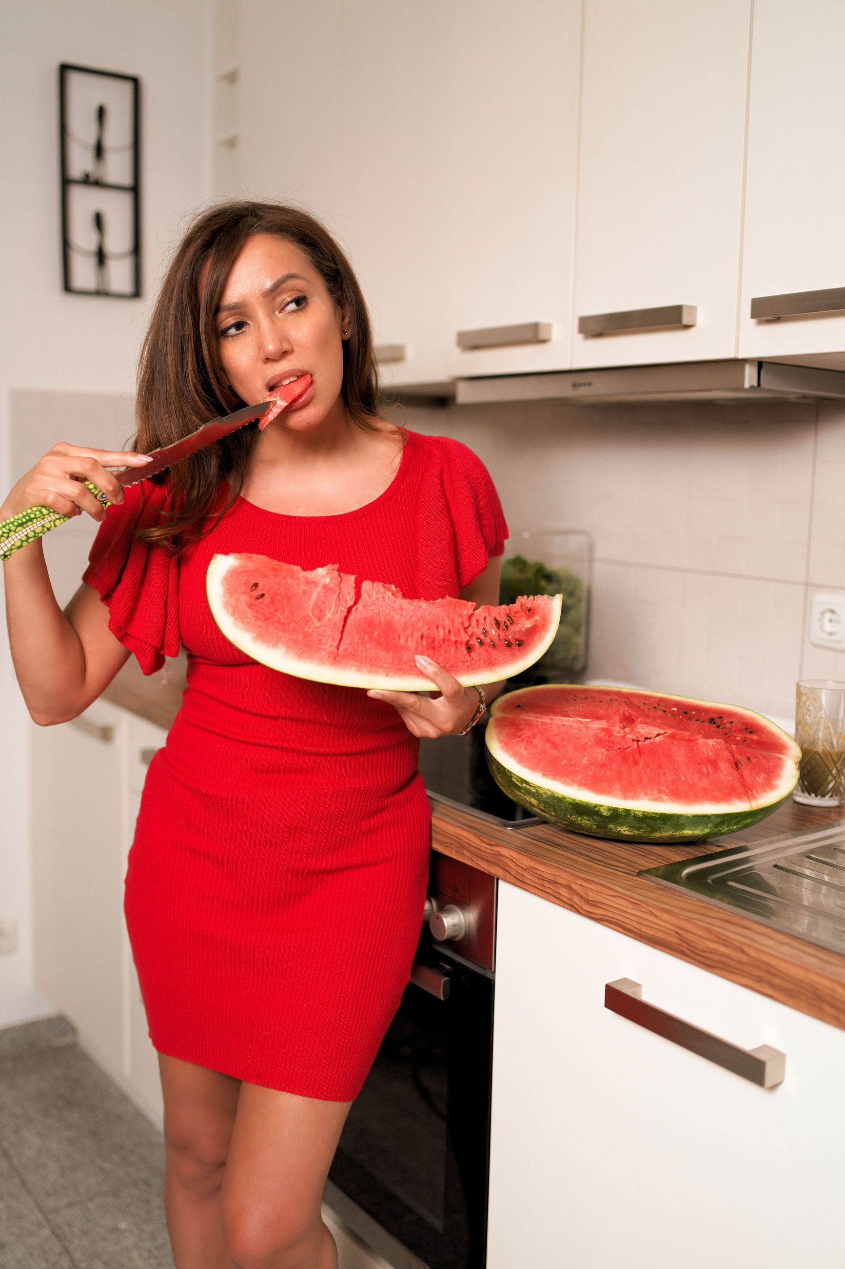 red, food, food and drink, kitchen, one person, healthy eating, wellbeing, domestic room, fruit, domestic kitchen, lifestyles, indoors, women, front view, freshness, home, domestic life, young adult, preparation, vegetable, preparing food, beautiful woman