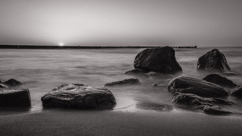 Black and White Stones at the Waterfront Beach Beauty In Nature Black And White Black And White Collection  Black And White Photography Dusk Horizon Horizon Over Water Land Long Exposure Motion Nature No People Rock Rock - Object Scenics - Nature Sea Sky Solid Sunset #sun #clouds #skylovers #sky #nature #beautifulinnature #naturalbeauty #photography #landscape Tranquil Scene Tranquility Water Waterfront Waterstones