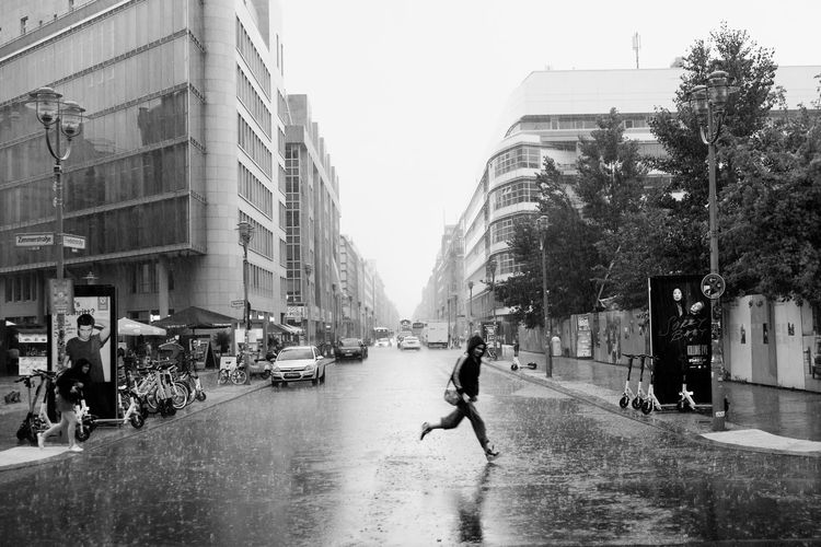 People walking on street in rain