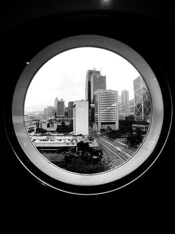 Architecture City Built Structure Building Exterior Tower Circular Window Skyscraper Indoors  Day Cityscape Sky IPhoneography Moment Lens Superfish Light And Shadow Cityscape Pattern, Texture, Shape And Form Buildings & Sky Urban Skyline Architecture Black And White Hong Kong Skyline Black & White Rainy Day Urban Landscape