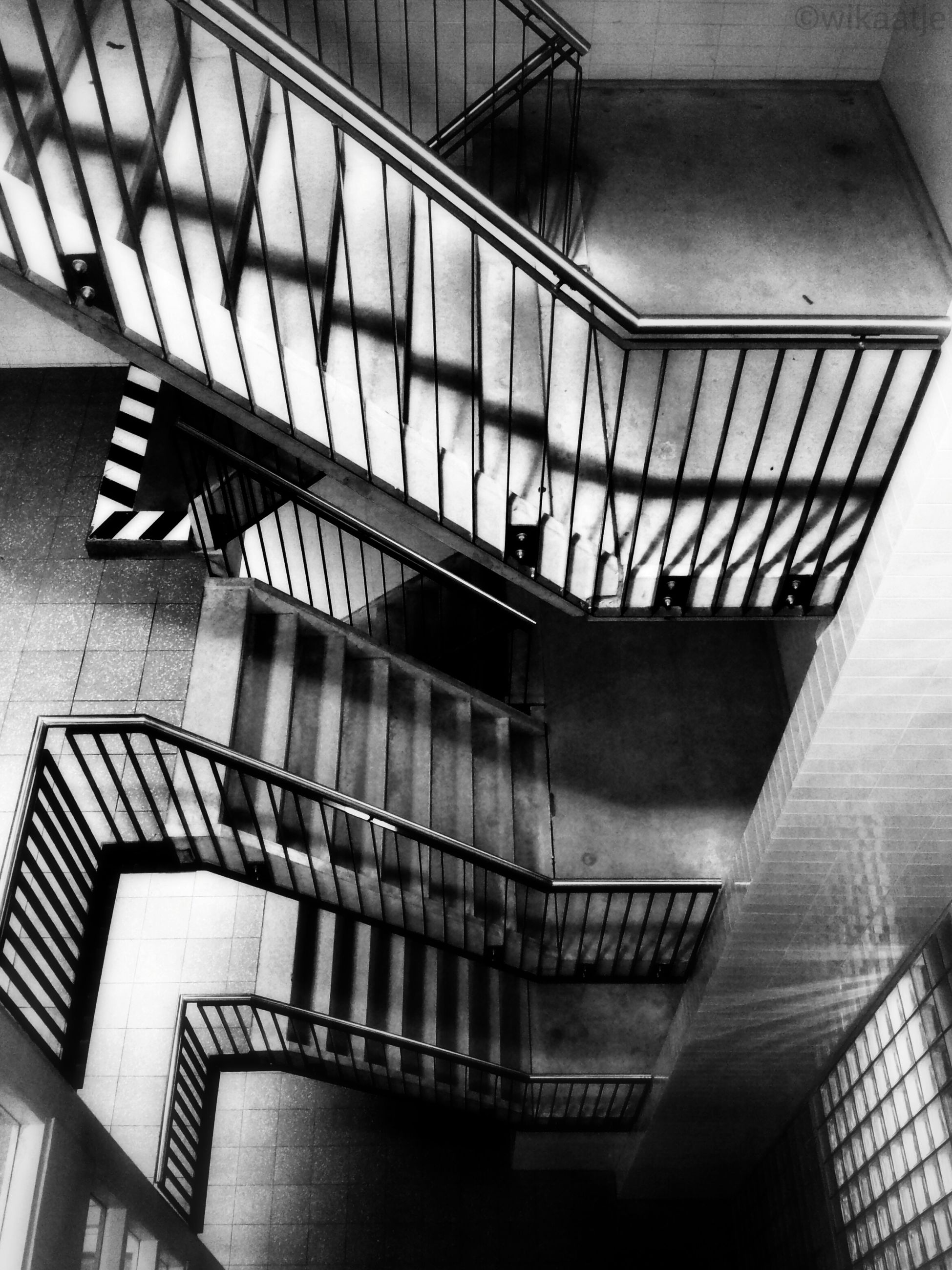 architecture, built structure, indoors, low angle view, ceiling, railing, staircase, building, modern, steps and staircases, steps, building exterior, architectural feature, interior, railroad station, no people, high angle view, day, metal, pattern