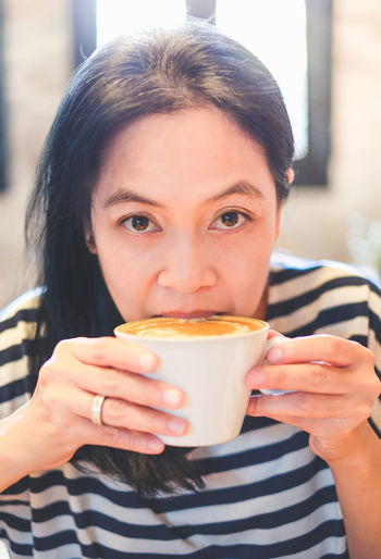 Close-Up Portrait Of Woman Drinking Coffee