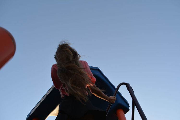 Childs play. Blue Child Childhood Girl Hair Hairstyle Looking Up Low Angle View Orange Pink Playful Playing Showcase March Sky Young Adult Young Women Women Who Inspire You Photography In Motion Live For The Story