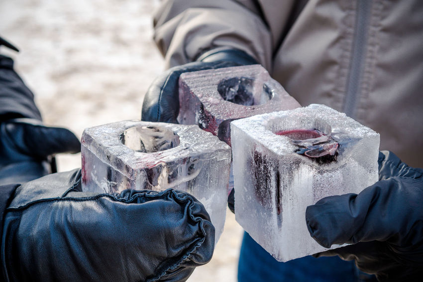 Enjoying whiskey in ice cube cup Ice Cup Ice Cube Winter Alcoholic Drink Cheers Close-up Day Holding Human Body Part Human Hand Ice Shots Low Section Men Midsection Outdoors People Real People Two People Whiskey