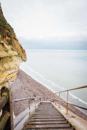 Seascape Sea Ocean Beach Staircase Stairs Stairway Water Landscape Beauty In Nature Tranquil Scene Railing Scenics - Nature Tranquility Sky Horizon Over Water Nature Day The Way Forward Horizon Idyllic Rock Solid No People Outdoors Long Calm Coastal Feature Coast Steps And Staircases