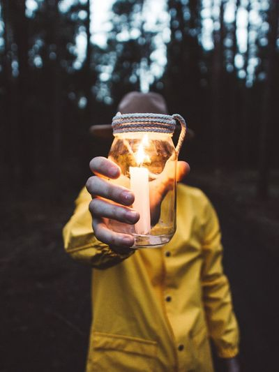 One Person Holding Front View Focus On Foreground Lifestyles Real People Illuminated Leisure Activity Standing Casual Clothing Human Hand Hand Lighting Equipment Tree Close-up Young Adult Nature Men Adult Warm Clothing