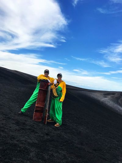 Nicaragua Cerro Negro Volcano Volcanic Landscape VolcanoBoarding Boarding Extreme Sports Adrenaline Junkie Adventure Jumpsuit Sky Lava Field Men Women Two People Real People Togetherness Standing Nature Bonding