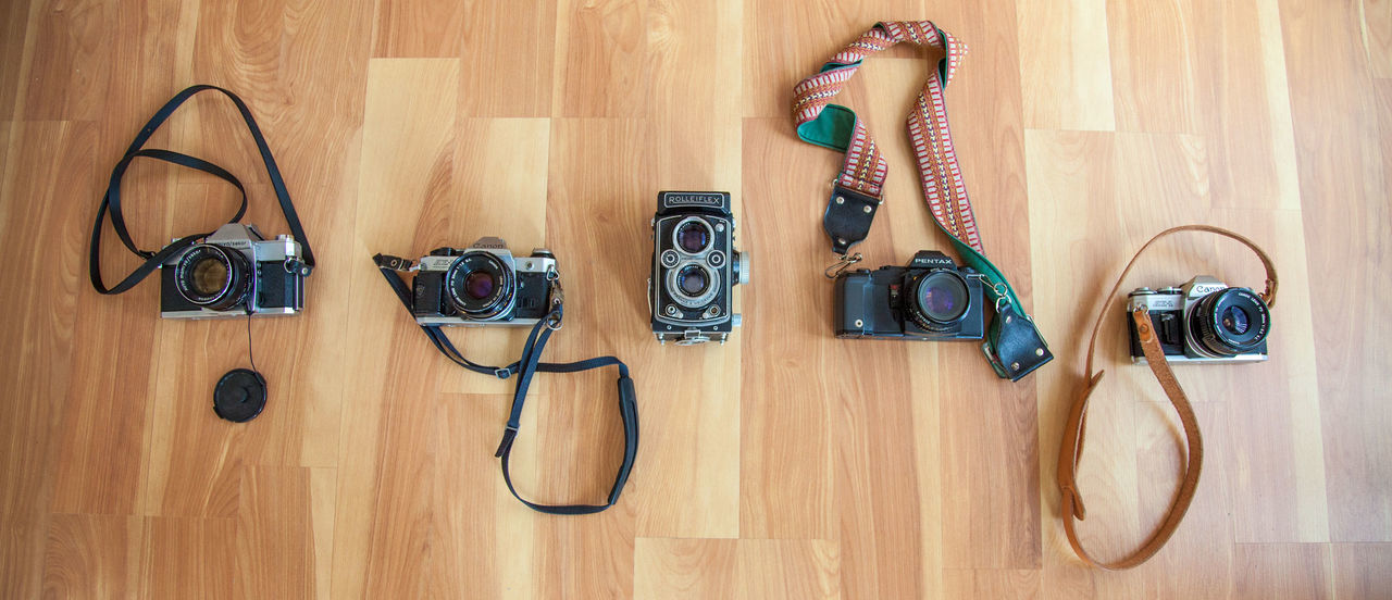 Arrangement Cameras Canon Choice Close-up Directly Above Flooring Hanging Hardwood Floor High Angle View Home Interior Indoors  No People Old School Camera Side By Side Still Life Table Twin Lens Reflex Variation Vintage Camera Vintage Photo Wood - Material