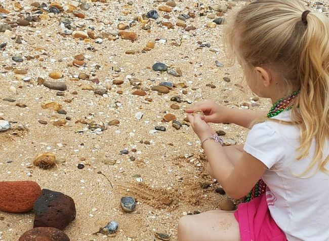 Live For The Story Sand Beach Child Childhood One Girl Only Summer Stones And Pebbles Blond Hair Stones Are The Best Toys Sitting Real People