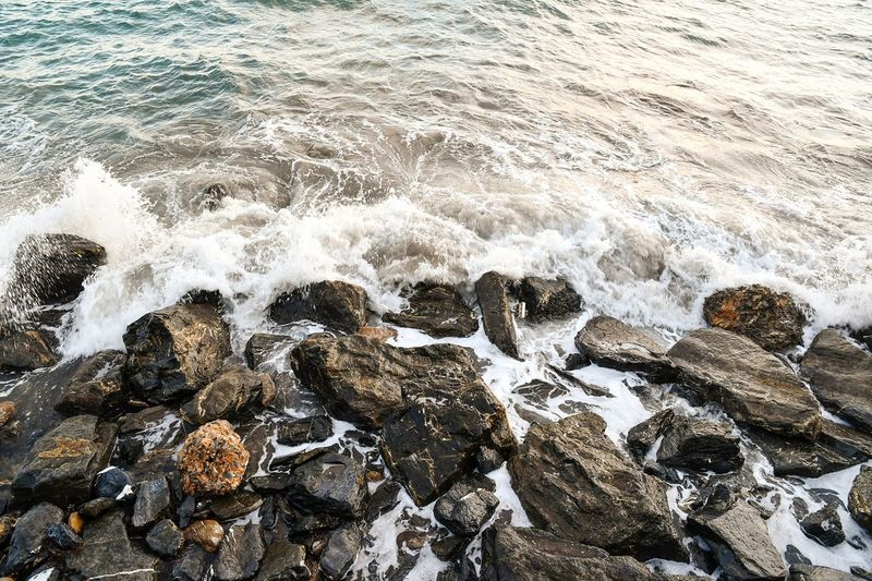 rocks and sea Rocks And Water Rocks Sea Rocks And Sea Nature Freshness Water Waves Waves Crashing Waves And Rocks Beauty In Nature Travel Destinations From Above  Textured  Natural Texture Fresh Day
