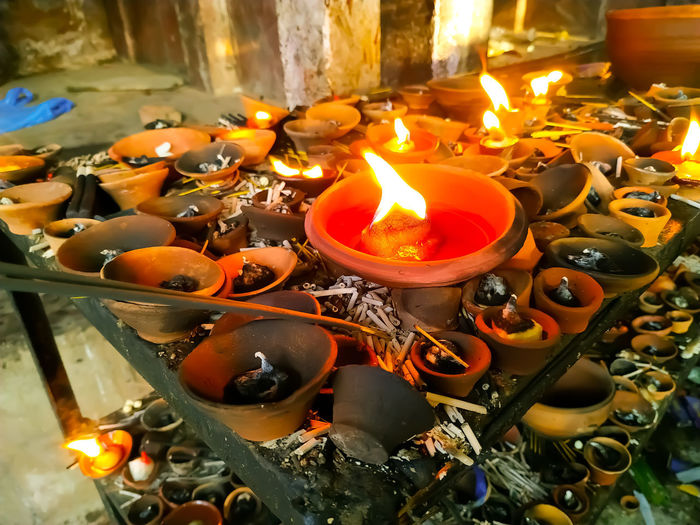 High angle view of lit candles in temple