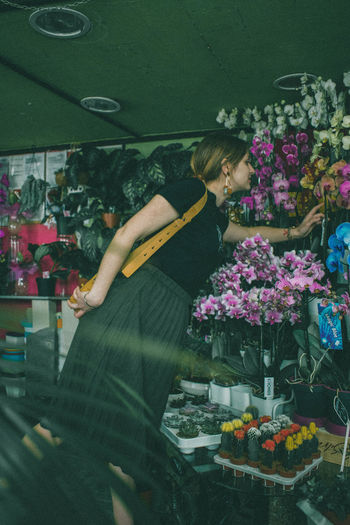 Flower Retail  Flowering Plant Plant Women Real People Store One Person Business For Sale Flower Shop Small Business Shopping Indoors  Retail Display Lifestyles Standing Vulnerability  Choice Flower Arrangement Florist Consumerism Bouquet Flower Head