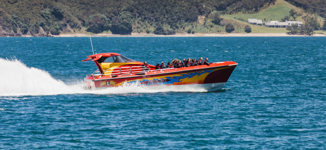 Racing boat with tourists in Bay of Islands, New Zealand Adrenaline Junkie Bay Of Islands Coastline Fun New Zealand Scenery Racing Boat Tourist Water Sport Adventure Aquatic Sport Boat Full Length Motorboat Nautical Vessel New Zealand Sea Side View Speed Speedboat Splashing Tourboat Tourism Wake Wake - Water Water