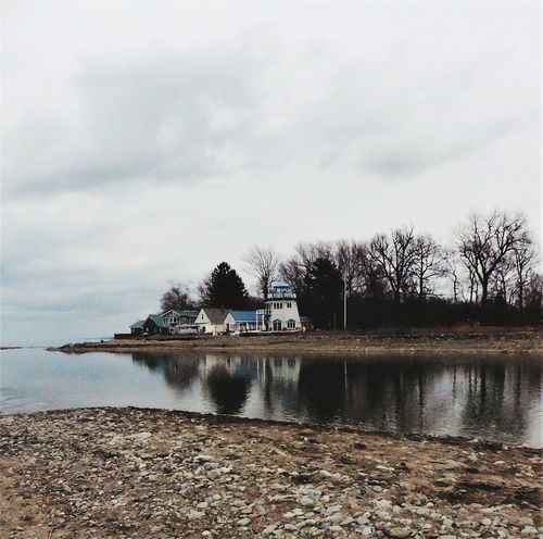 Tree Reflection Water Nature Extreme Weather Cloud - Sky Outdoors No People Lake Sky Storm Cloud Day Waterfront Lighthouse_lovers Lighthousephotography Beach Beach Life Beach View Beach Photography Beach House Sand Lake Erie Lakeview Winter Weather First Eyeem Photo