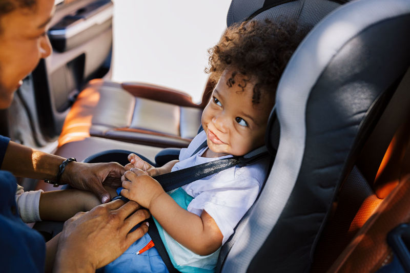 Mother with son sitting in car