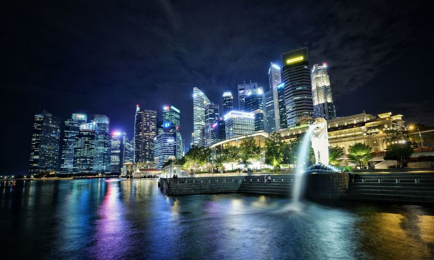 The Lion City Night Lights Blue Modern City Neon Lights Night Night Lights Singapore City Night Building Exterior Architecture Illuminated Built Structure City Building Water Office Building Exterior Modern Skyscraper Waterfront Cityscape Tall - High Travel Destinations River Outdoors
