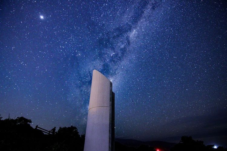 Architecture Astronomy Beauty In Nature Building Exterior Built Structure Galaxy Infinity Low Angle View Milky Way Nature Night No People Outdoors Scenics - Nature Sky Space Star Star - Space Star Field Tower Tree