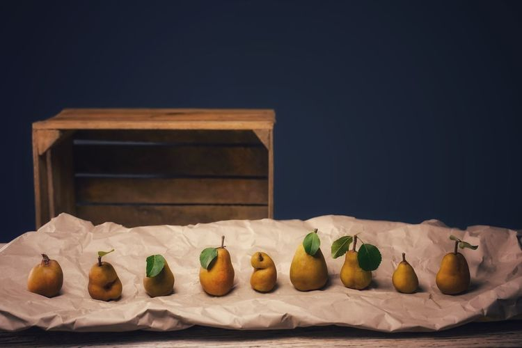 Ripe pear fruits on brown paper. ecological fruits in natural shapes, crooked or straight
