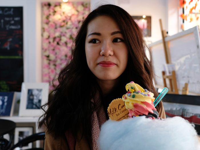Portrait of a young woman in cake
