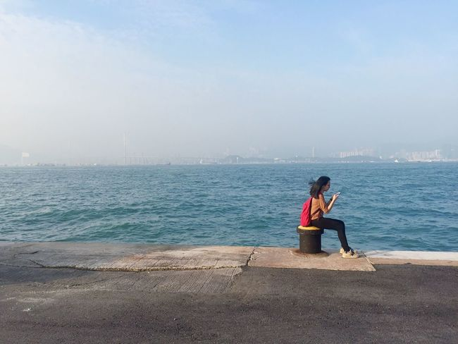 Sea Water Full Length Sitting Leisure Activity Nature Day Real People Beach Horizon Over Water Outdoors Lifestyles Sky Beauty In Nature Scenics Young Adult Young Women Adult People TCPM