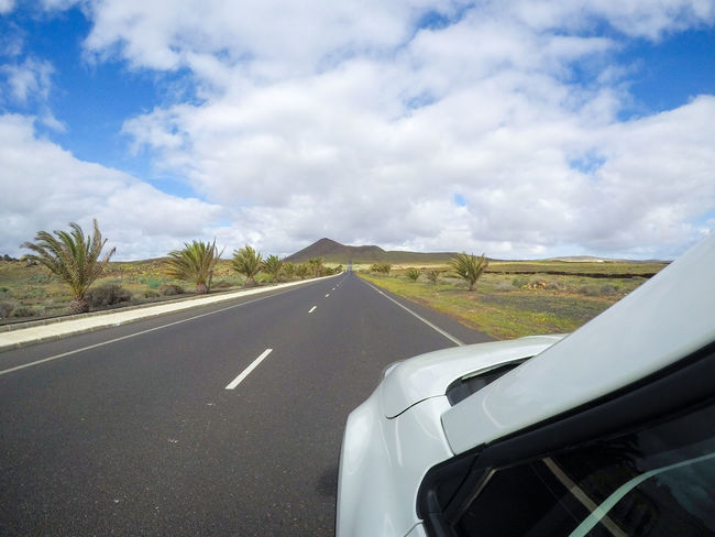 Driving by car on the island of Lanzarote Canary Islands Lanzarote Lanzarote Island Rental Car SPAIN Car Rental Cloud - Sky Landscape Mode Of Transportation Road Sky Transportation Travel Travel Destinations