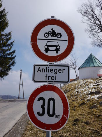 Trafficsign in south Germany Allgäu Guiding Traffic Circle Close-up Communication Day Guidance Guide Nature No People Outdoors Road Sign Sky Speed Limit Sign Traffic Sign Tree