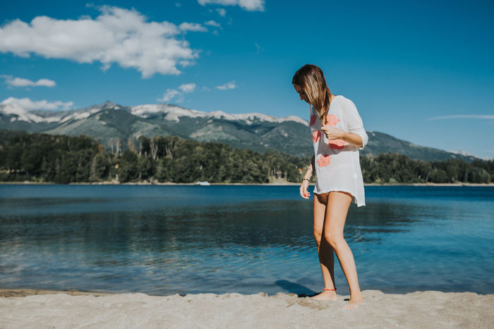 Argentina Bahia Manzano Beach Beauty Blue Cloud - Sky Full Length Fun Happiness Mountain Mountains Nature One Person One Woman Only Outdoors Peace And Quiet People Relaxation Shorts Summer Travel Destinations Vacation Time Vacations Vacations Villa La Angostura