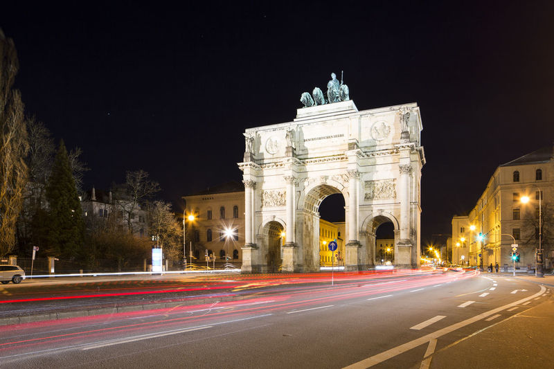 A night time long exposure of the Siegestor in Munich City Centre in Germany. Siegestor München Illuminated Light Trail Architecture Motion Long Exposure Road Built Structure City Night Monument Transportation Travel Destinations Blurred Motion Speed Street History The Past Arch No People City Street Outdoors München Germany City Life