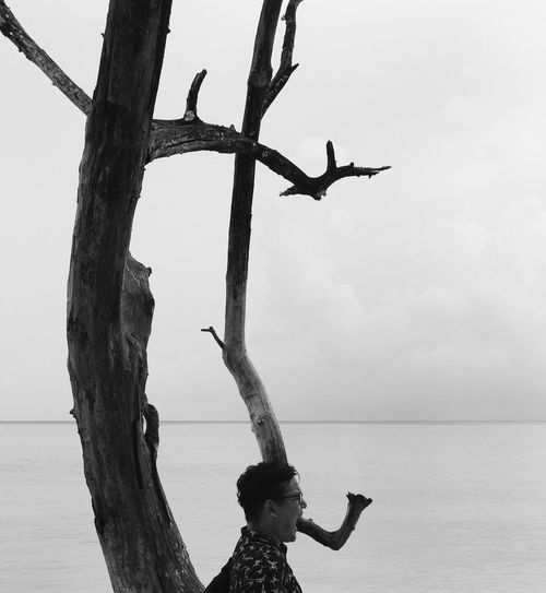 Sea Water Sky Outdoors One Person Day Nature Horizon Over Water Full Length Tree Real People Flying Beauty In Nature Bird People