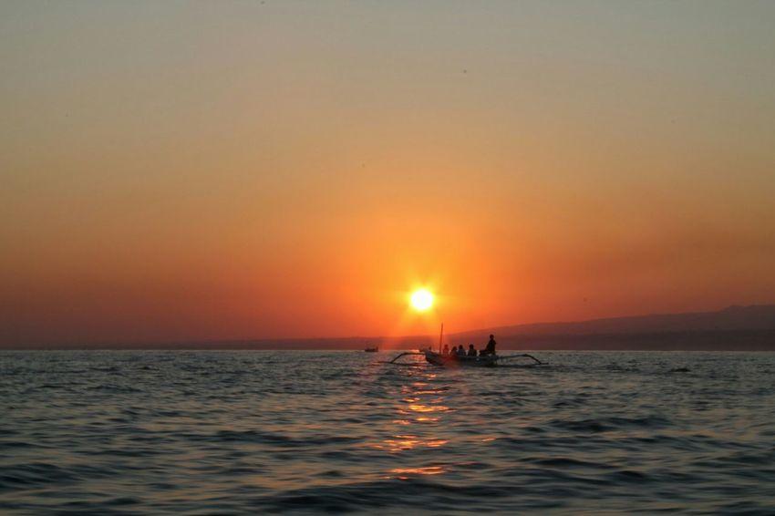 Sun fishers Beach Sunset_collection Lovina Beach Bali, Indonesia Beach Photography Sunset Orange Sunrise Boat Fisherman Sun_collection Sunrise_sunsets_aroundworld