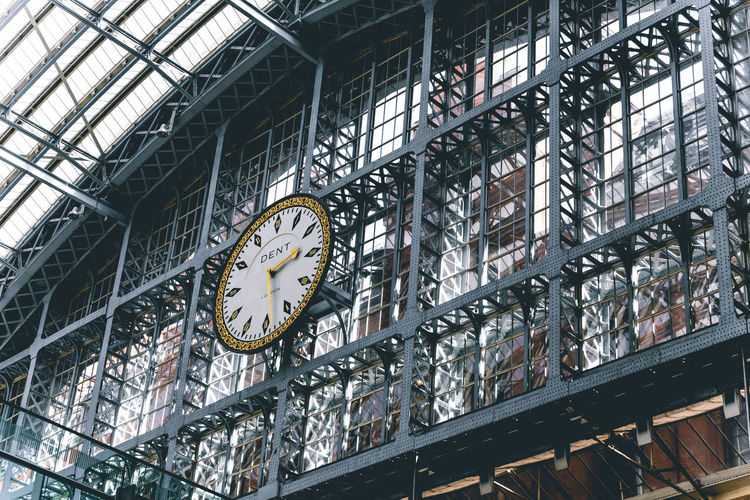 Time Clock Low Angle View Architecture No People Built Structure Indoors  Metal Instrument Of Time Railroad Station Ceiling Accuracy Shape Day Pattern Illuminated Hanging Circle Geometric Shape Minute Hand Clock Face