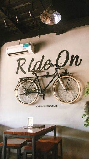 High angle view of bicycle sign on table