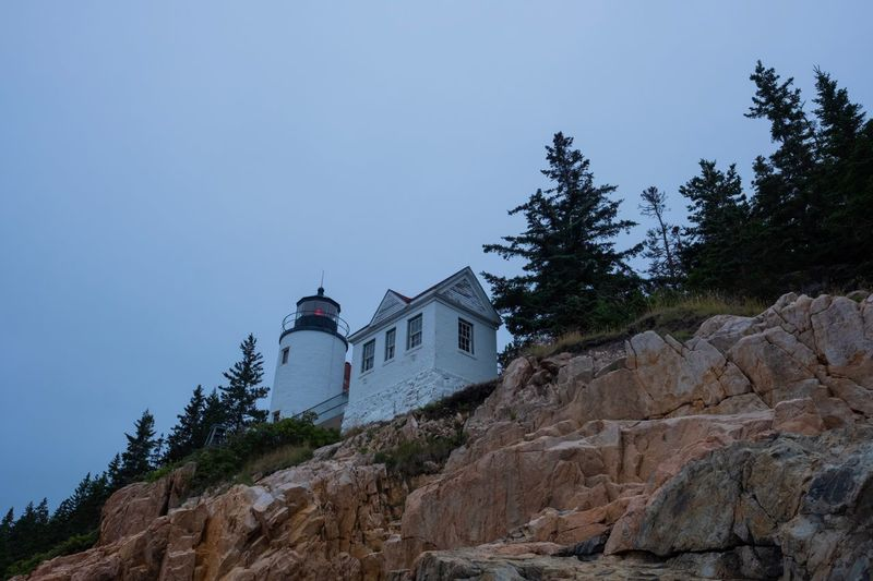 High Ground Cliffs Copy Space Ocean Landscape Nature Moody Adventure Bass Harbor Lighthouse Red Light Maine Acadia National Park Fujifilm Cloudy Overcast Lighthouse Architecture Built Structure Building Exterior Tree Sky Building Plant Low Angle View Nature No People History Outdoors Stone Wall