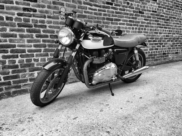 Black And White Brick Brick Wall Day Land Vehicle Mode Of Transport Monochrome Motorbike Motorcycle Outdoors Parked Parking Stationary Transportation