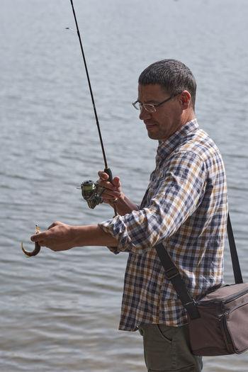 Fisherman caught a small fish