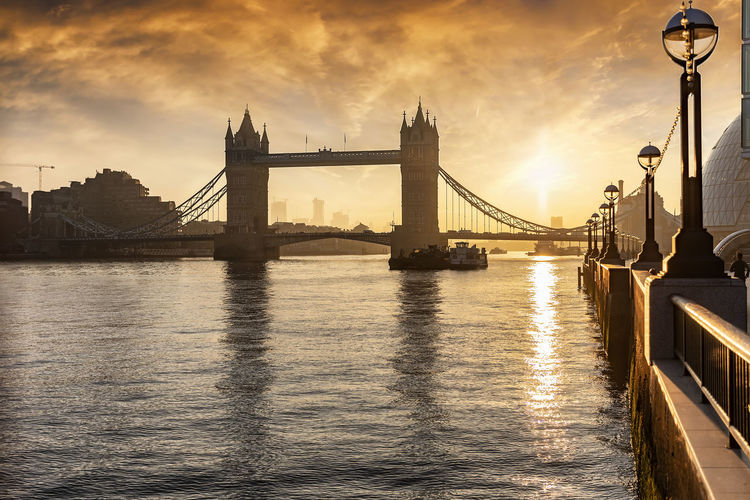 The Tower Bridge of London, major tourist attraction, during sunrise Bridge Built Structure River Water Cloud - Sky Architecture Travel Destinations City Building Exterior Travel Tourism Sunset Sky London Tower Bridge  Sunrise Morning Tourist Attraction  Thames River Sunlight Reflection United Kingdom Outdoors Landmark Sightseeing