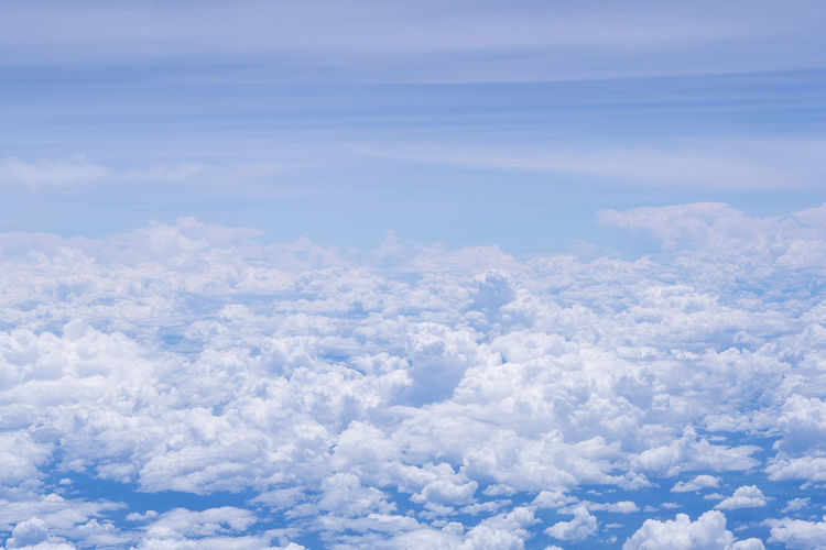 Aerial view of cloudscape seen through airplane window