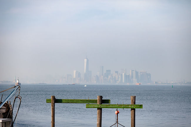 View from Staten Island overlooking a faint Manhattan in the background. Architecture Building Exterior Cityscape Manhattan Modern New York City NYC Scenics Skyscraper Staten Island Travel Destinations Travel Photography Water