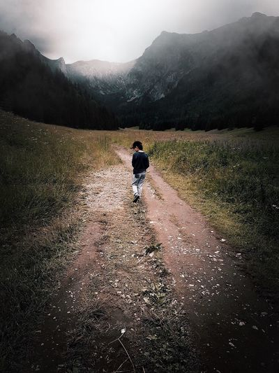 Mountain Walking Rear View Real People Nature The Way Forward Full Length Boy Adventure Lifestyles Day Child Road Leisure Activity Landscape Tatra Mountains Beauty In Nature Outdoors Grass Sky EyeEmBestPics EyeEm Best Shots EyeEm Best Edits EyeEm Gallery The Week On Eyem Breathing Space Your Ticket To Europe Been There.