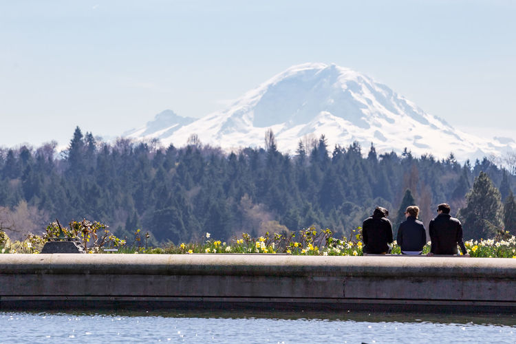 Tourists with snow covered mountain in background