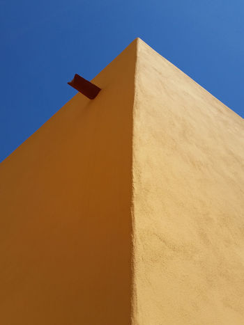 Copy Space Light Mediterranean  Natural Light Wall Architecture Blue Blue Sky Building Exterior Colorful Drains Italy Liguria Low Angle View Minimalism No People Old Outdoors Shadow Sidelight Sky Sunlight Village Warm Yellow