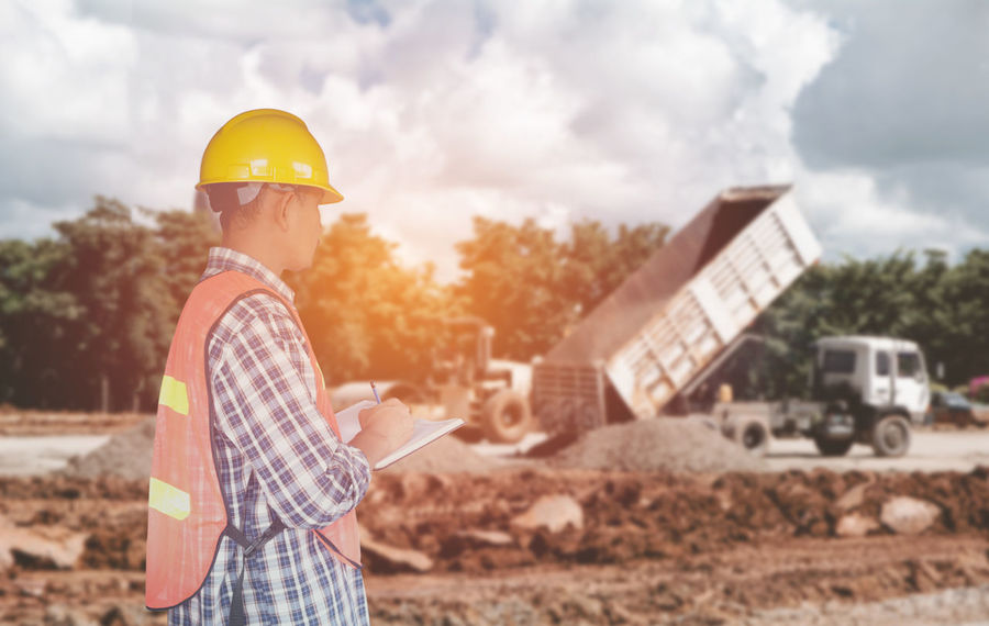 Adult Architecture Cloud - Sky Construction Site Construction Worker Engineer Growth Hardhat  Headwear Helmet Industry Maintenance Engineer Manual Worker Men Occupation One Man Only One Person Only Men Outdoors Protective Workwear Real People Sky Work Helmet Working Young Adult