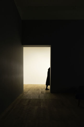 Man standing at doorway